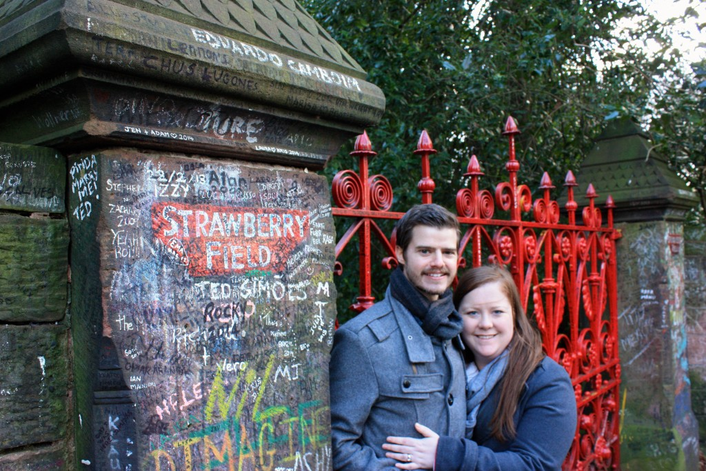 Katy and Albert in front of the gates to Strawberry Field